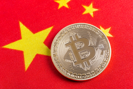 Bitcoin real coin over chinese flag fabric
