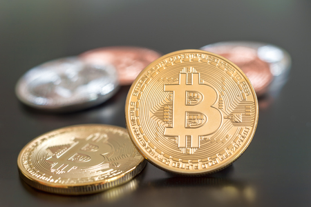 Cryptocurrency Bitcoin metallic coins over grey background