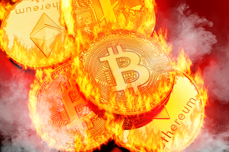 Conceptual picture of cryptocurrency coins bursting into flammes, illustrating crypto-currency market crash Reklamní fotografie