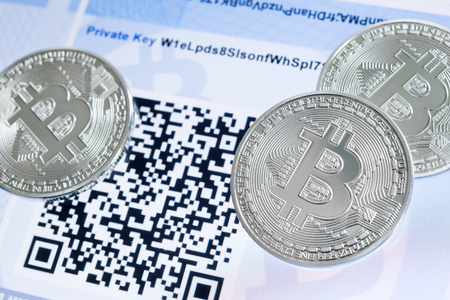 Cryptocurrency Bitcoin metallic coins, QR code and paper wallet. Reklamní fotografie