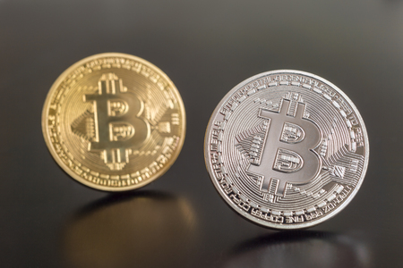 Two cryptocurrency Bitcoin metallic coins over grey background Reklamní fotografie