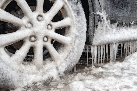 Ice buildup and icicles on a car and close-up of a frozen wheel, in Montreal, Canada. Reklamní fotografie
