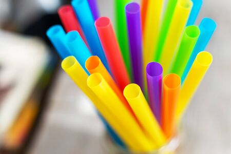 Top view of bright colorful plastic drinking straws and tubes
