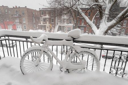 Bike covered with fresh snow in Montreal, Canada (January 2019)