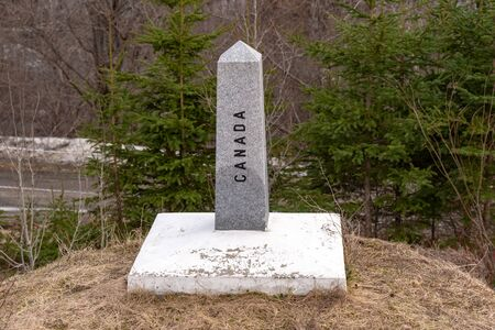 A boundary stone marks the USCanada border in Quebec, near Coaticook.