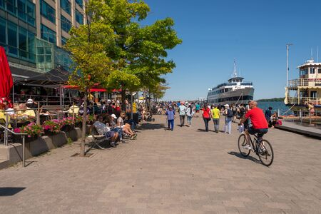 Toronto, Canada - 22 June 2019: People enjoying a warm summer day at the harbourfront