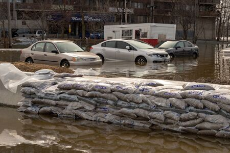 Pierrefonds-Roxboro, Quebec, Canada - 29 April 2019: Cars submerged during spring floods