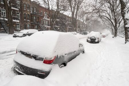 Montreal, Canada - 20 January 2019: Cars covered with snow during snow storm. Publikacyjne