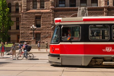 Toronto, Canada - 22 June 2019: Street car in Downtown Toronto going on College street