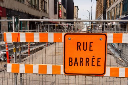 Montreal, Canada - 03 September 2019: Construction site on Sainte-Catherine street. Rue Barrée means closed road in french.