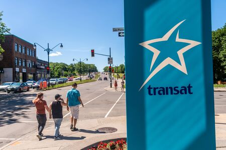 Montreal, CA - 7 July 2019: Air Transat Sign at the bottom of Air Transat tower.