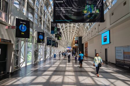 Toronto, Canada - 22 June 2019:  People walking through the Skywalk in Union Station. Editorial
