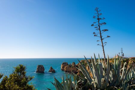 View of Lagos coastline in Portugal, Ponta da Piedade in the distance