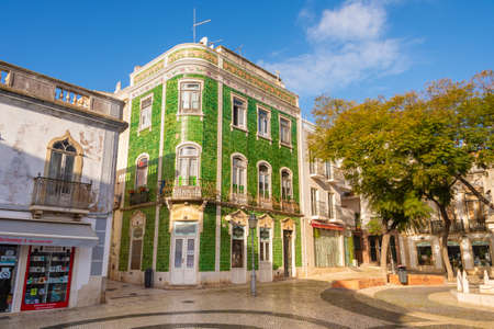 Lagos, Portugal - 5 March 2020: House with green ceramic tiles at the Praca de Camoes