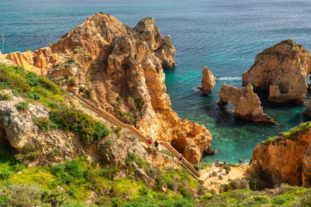 Lagos, Portugal - 6 March 2020: Tourists visiting Ponta da Piedade