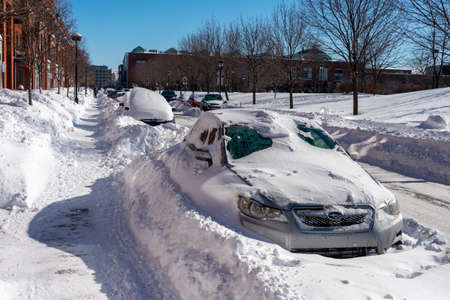 Montreal, CA - 8 February 2020: Street and cars covered in snow during winter storm in Angus district