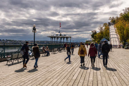 Quebec City, Canada - 4 October 2019: Tourists walking on the pedestrian walkway near Chateau Frontenac