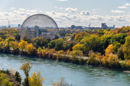 Montreal, CANADA - 15 October 2019: Biosphere & Saint-Lawrence River from Jacques-Cartier Bridge in the autumn season.