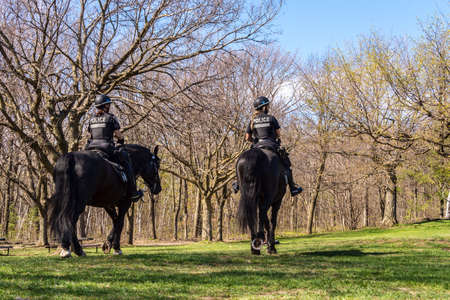 Montreal, CA - 18 May 2020: Horse Mounted Police in Mount Royal Park