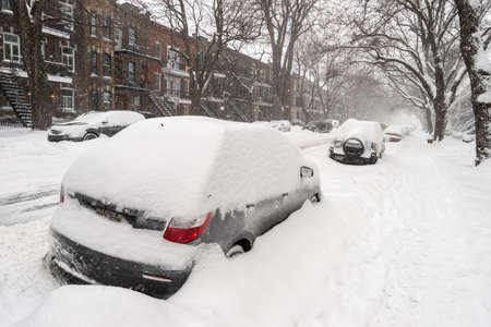 Montreal, Canada - 20 January 2019: Cars covered with snow during snow storm. Редакционное
