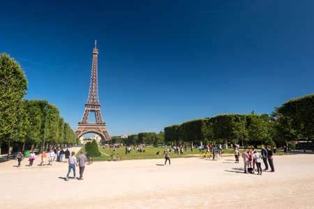 Paris, France - 23 June 2018: Eiffel Tower from the Champ de Mars gardens in summer.