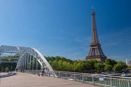 Paris, France - 23 June 2018: Debilly Footbridge with Eiffel Tower in the background.
