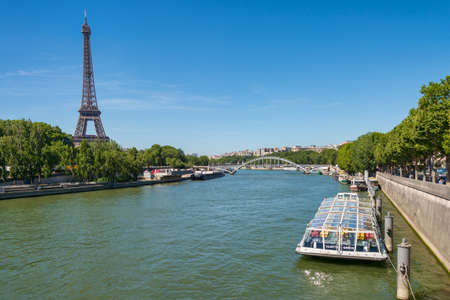 Paris, France - 23 June 2018: Bateau Mouche on the Seine river with Eiffel Tower in the background
