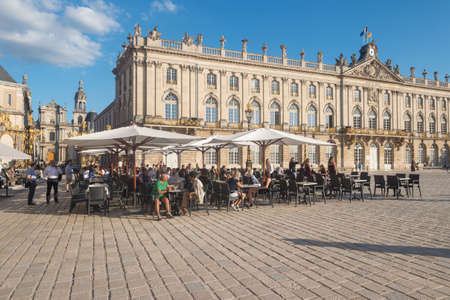 Nancy, France - 20 June 2018: Café Terrace in the Place Stanislas square at sunset.