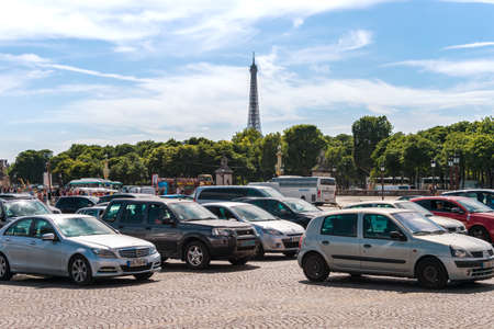 Paris, France - 23 June 2018: Traffic on Place de la Concorde with Eiffel Tower in the distance.