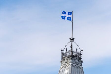 Quebec Flag at the top of the Quebec Parliament building in Quebec City.