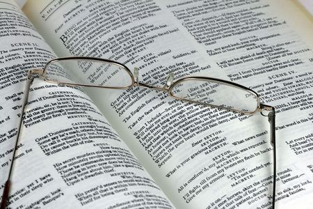 macbeth: A pair of reading glasses and a book showing pages of Shakespeare�s Macbeth. Stock Photo