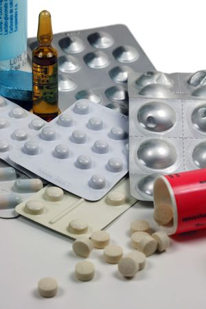 Several containers with various kinds of medicines.