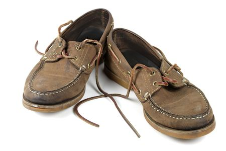 A worn out pair of nautical shoes. Stock Photo