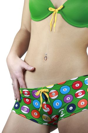 A girl in colorful lingerie with a navel piercing. Stock Photo