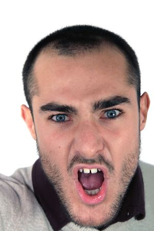 A young man shouting with aggressive gesture. Stock Photo