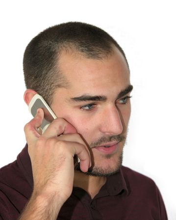 An attractive young man with a mobile phone. Stock Photo