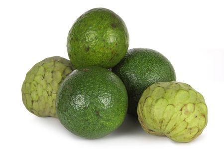 Custard apples and avocados on a white background. Stock Photo