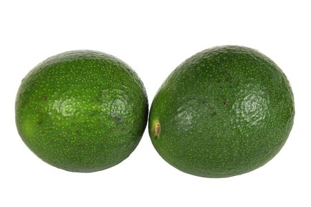 Two avocados isolated on a white background.