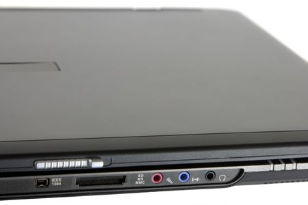 A laptop computer showing some of its external connections, including a Firewire port.