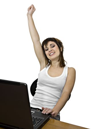 A girl in a victorious attitude with a laptop computer Stock Photo
