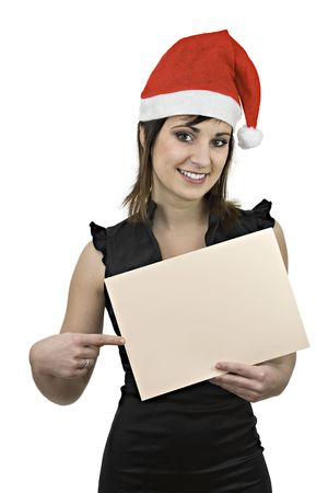 A girl in black dress wearing a Santa Claus cap and pointing at a blank sign