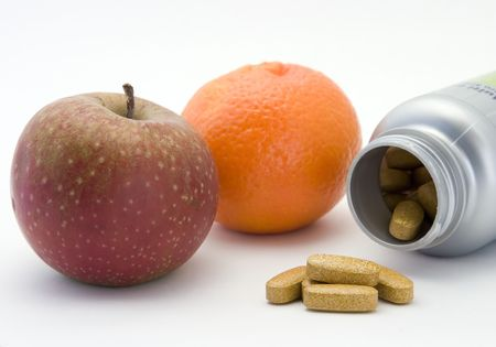 medical decisions: artificial and natural vitamins Stock Photo