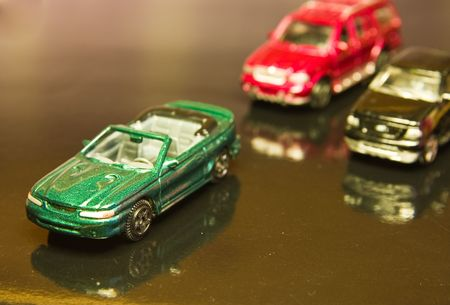 overtake: toy cars on a reflective surface