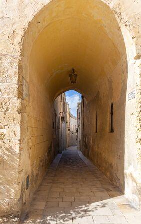 doorway to an tiny and narrow street in Mdina Malta Stok Fotoğraf