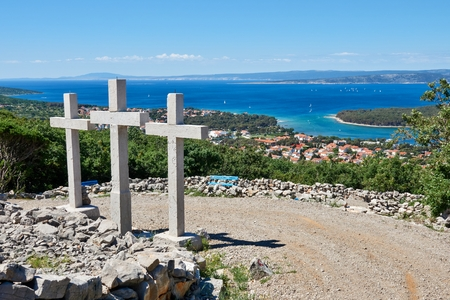 Three crosses over the town of Punat on the island of Krk, Croatia, Europe
