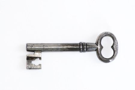 Antique key on white photo