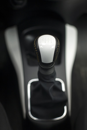 gearshift: Modern gear shift lever in a luxury car,soft focus,close up