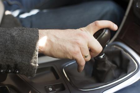 gearshift: Car interior, elegant man, hand on a a gear shift lever