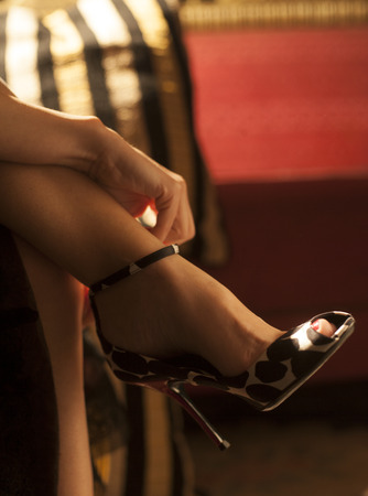 Female foot in sexy fashionable high heel shoe shallow focus
