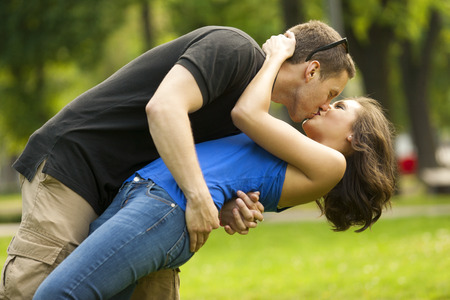he she: Young couple in love outdoorin lovekissing and embracing